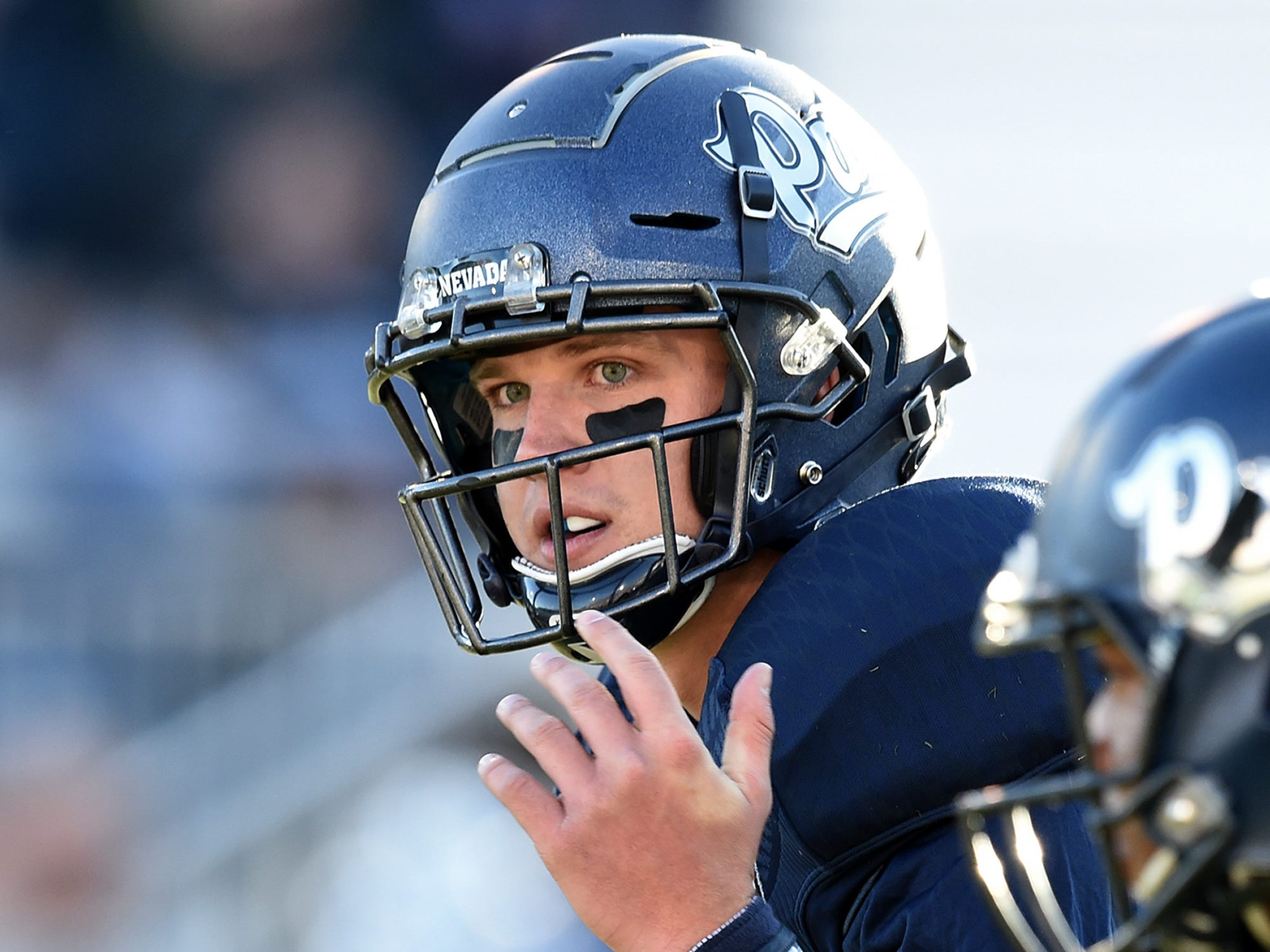 Nevada QB Ty Gangi signals during a play against Oregon State at Mackay Stadium on Sept. 15, 2018.