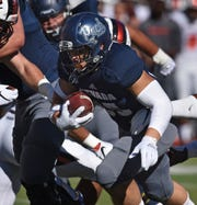 Nevada's Toa Taua runs against Oregon State at Mackay Stadium last season.