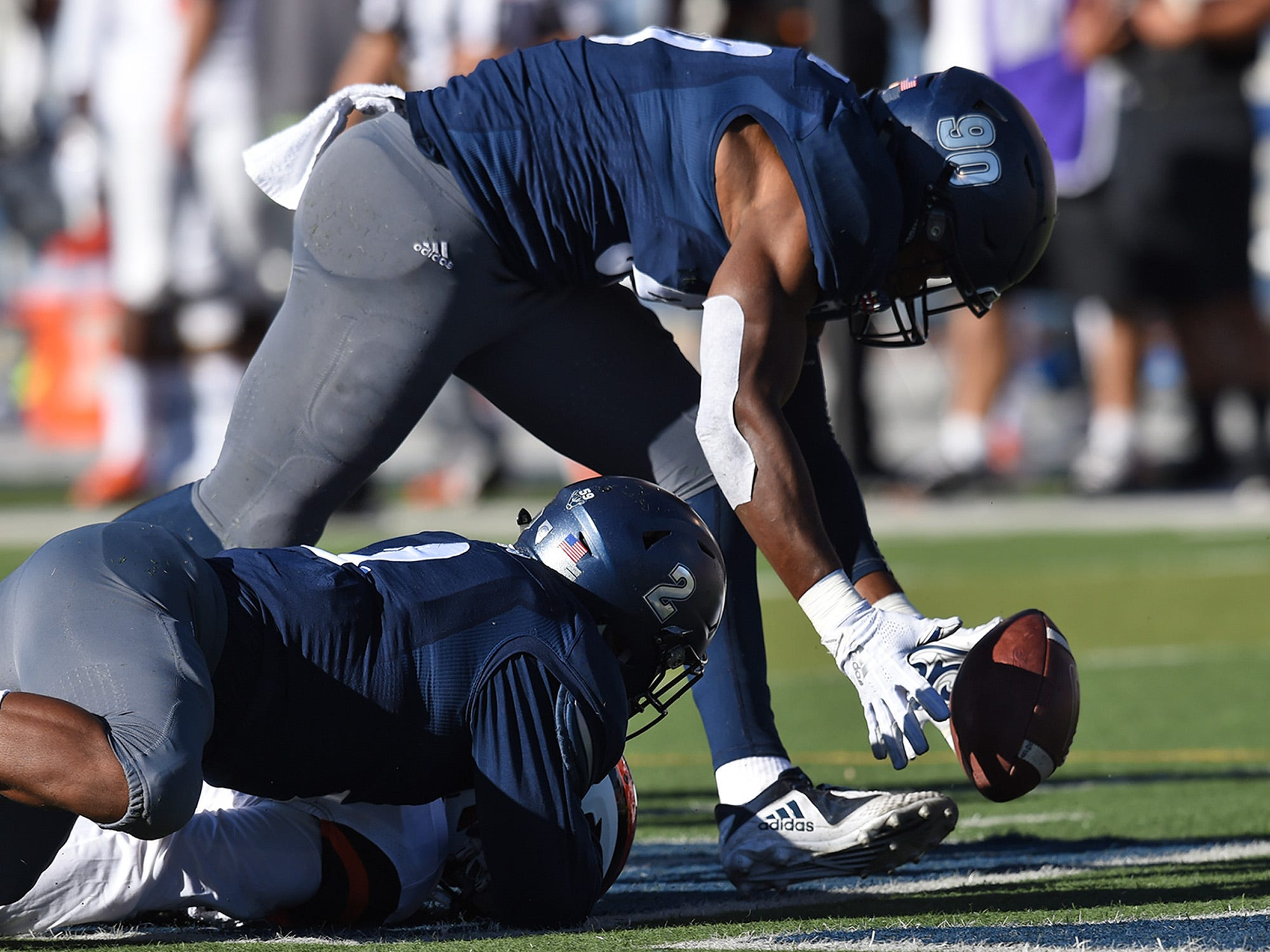 Nevada DE Malik Reed picks up a fumble by Oregon State QB who fumble the ball after he was tackled by Asauni Rugus at Mackay Stadium on Sept. 15, 2018.
