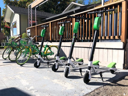 Lime Scooters and Lime Bikes parked in front of Sup restaurant in Midtown in Reno in September 2018.