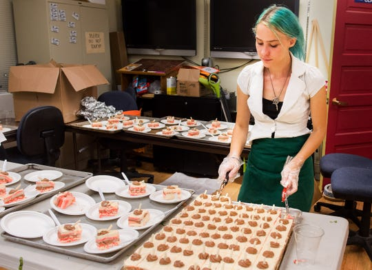Trista Nish dishes up dessert plates.