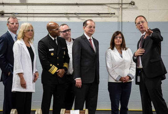 Members of the Trump administration, including Kellyanne Conway, Dr. Jerome Adams, Labor Secretary Alexander Acosta and Second Lady Karen Pence, listen to Belden plant manager David Hooper during a tour of the company's wire and cable facility on Tuesday, Sept. 18, 2018.