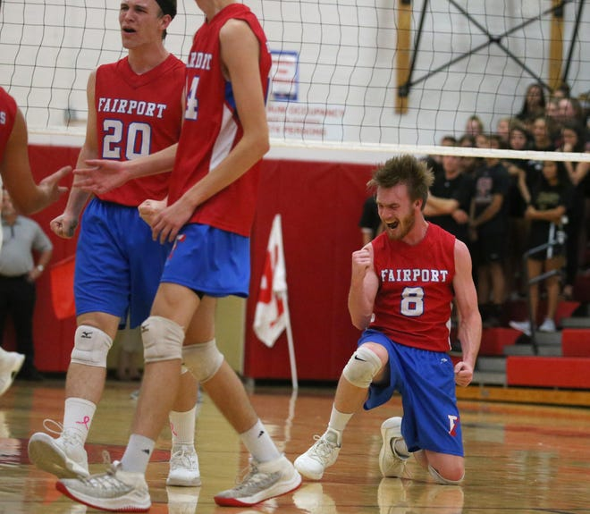 Fairport's Kade Carlson, right, celebrates a point as Fairport closes in on winning the opening set.