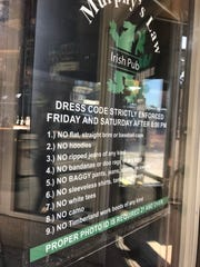Murphy's Law, at 370 East Ave., has this dress code posted in its window.