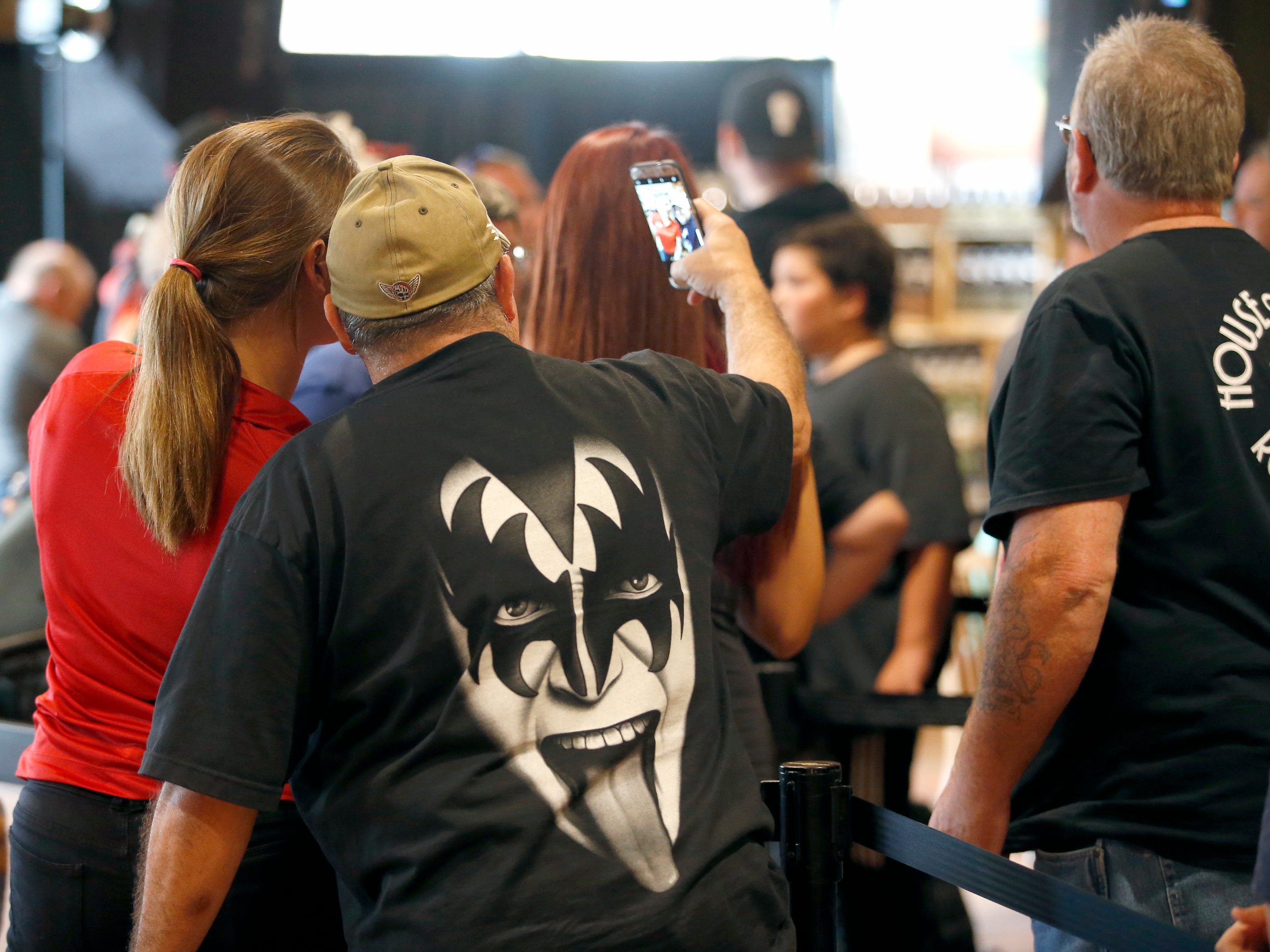 Fans try getting pictures of KISS co-founder Gene Simmons at the Chili-Paul Wegmans store to promote his MoneyBag Sodas.