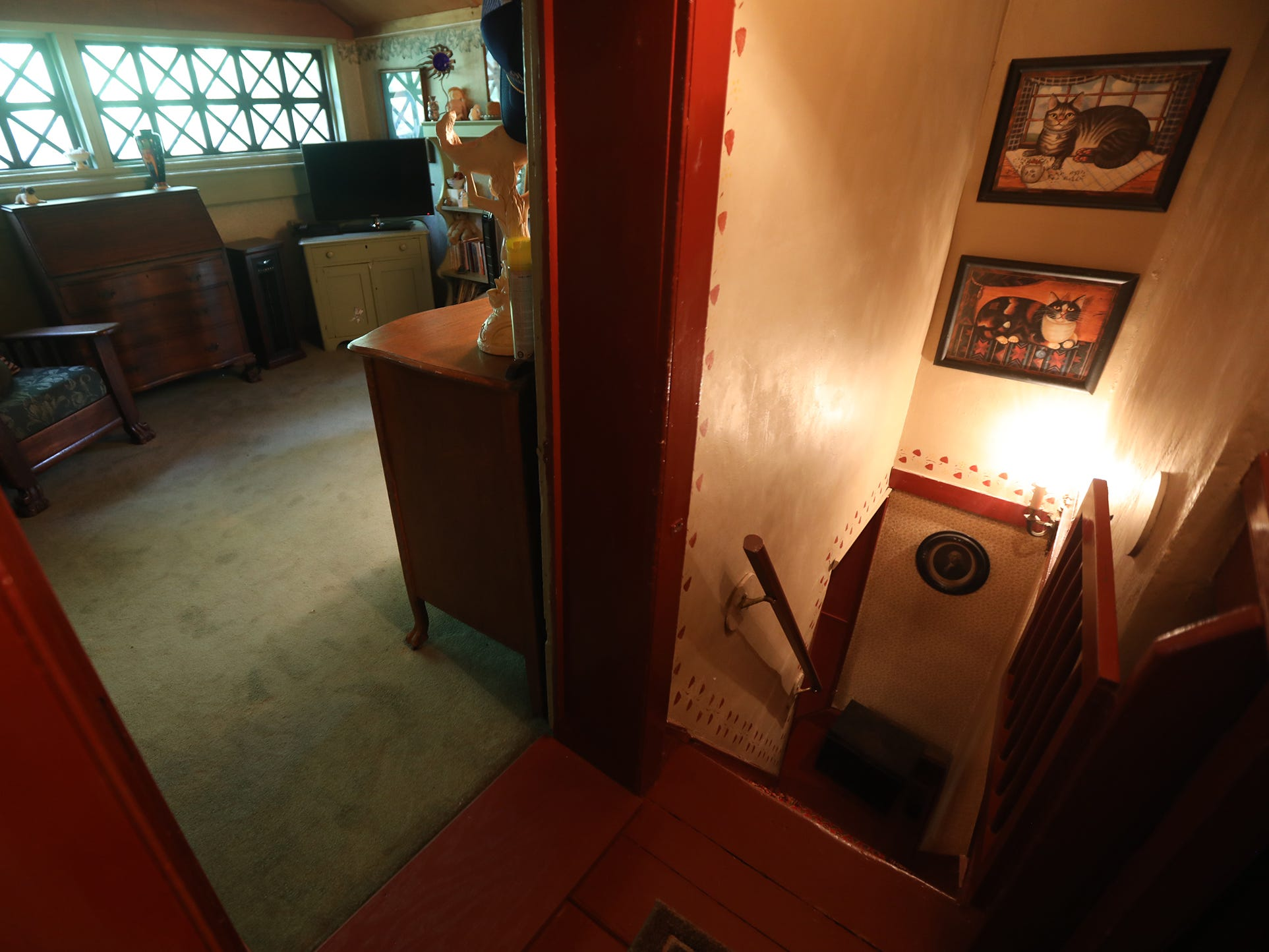 The narrow steep staircase on one side of the house leads from bedrooms down to the kitchen.