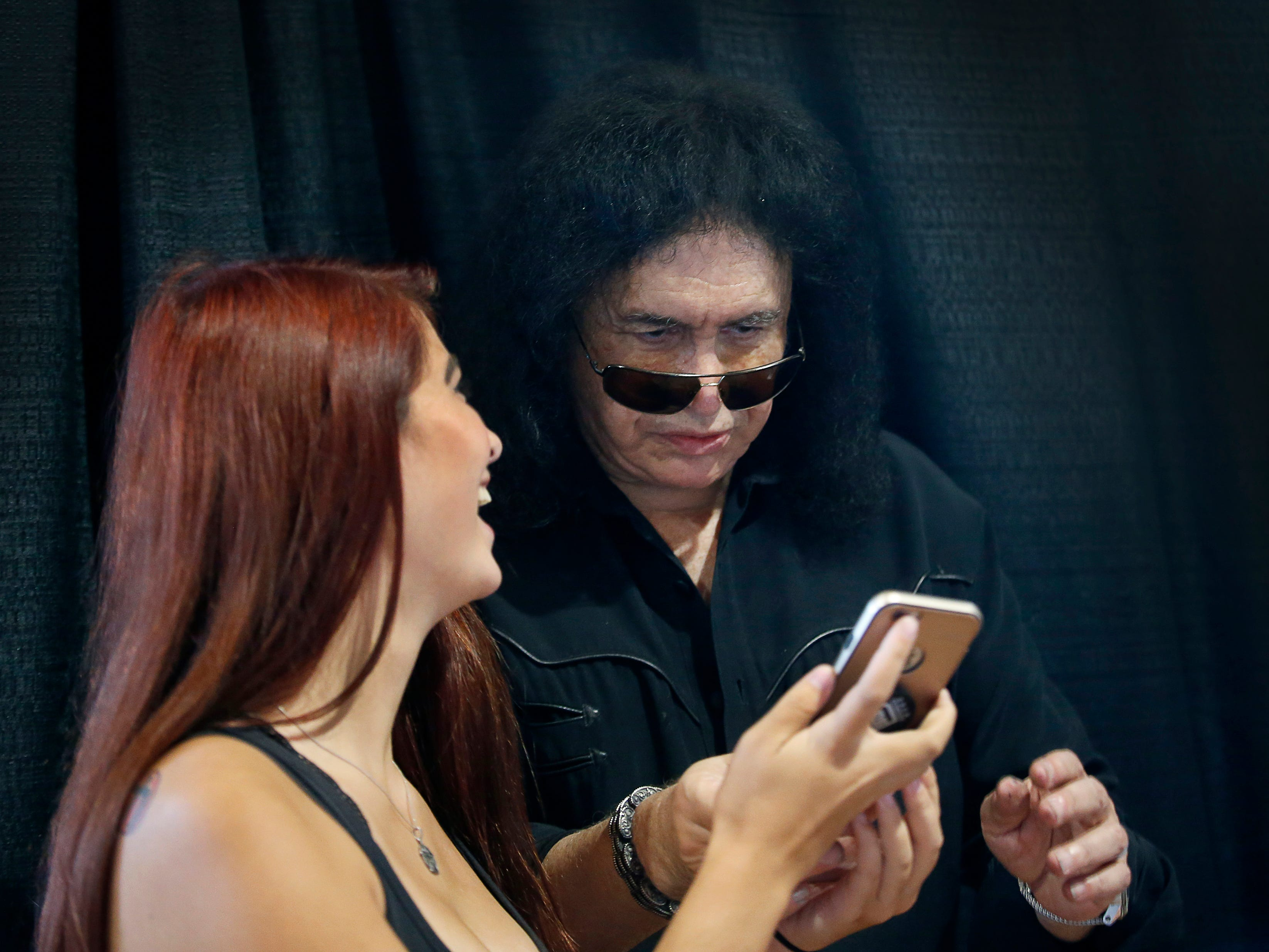 Taylor Murphy of Greece, has some laughs with KISS co-founder Gene Simmons at the Chili-Paul Wegmans store where he was promoting his MoneyBag Sodas.