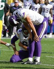 Minnesota Vikings kicker Daniel Carlson reacts after missing a field goal in the final seconds of overtime of  an NFL football game against the Green Bay Packers on Sunday.