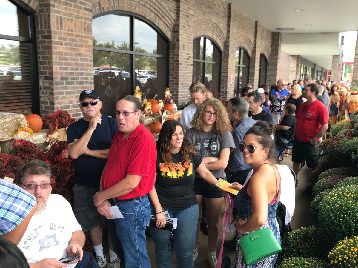 Fans wait in line Tuesday at Wegmans to see Gene Simmons