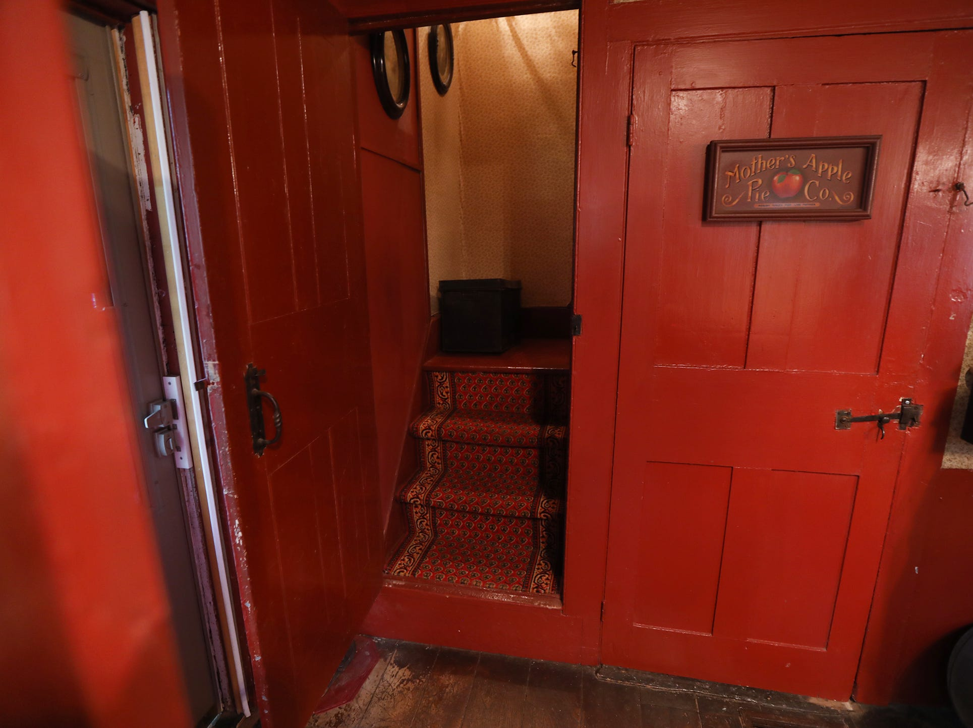 In the kitchen, a servants staircase leads up to several bedrooms and the other door leads to the basement.  The doors in the home have their original hardware.