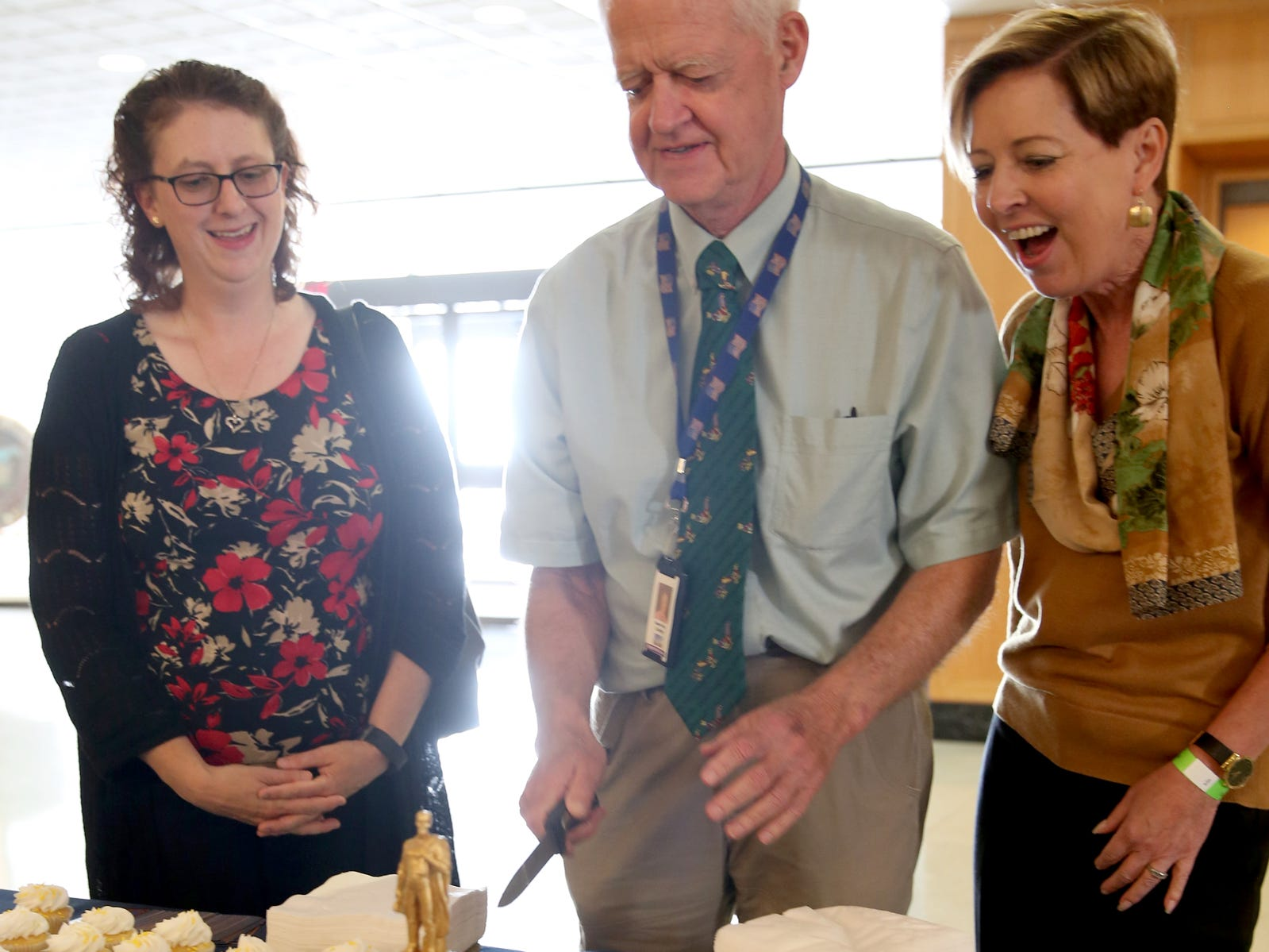 Jenny Lau, from left, who helped start a campaign to raise money to re-gild the Gold Man in 1984, Senate President Peter Courtney and Joan Plank, the Oregon State Capitol Foundation Chair, cut the birthday cake during an 80th birthday party for the Oregon Pioneer, aka the Gold Man, at the Oregon State Capitol in Salem on Tuesday, Sep. 18, 2018.