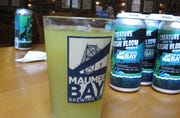 """A glass of """"Alegae Bloom"""" beer at Maumee Bay Brewing Co. in Toledo, Ohio, on Wednesday, Sept. 12, 2018."""