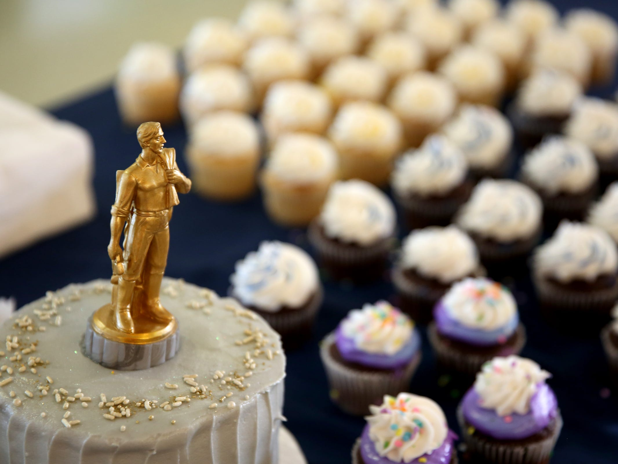 Cupcakes are served during an 80th birthday party for the Oregon Pioneer, aka the Gold Man, at the Oregon State Capitol in Salem on Tuesday, Sep. 18, 2018.