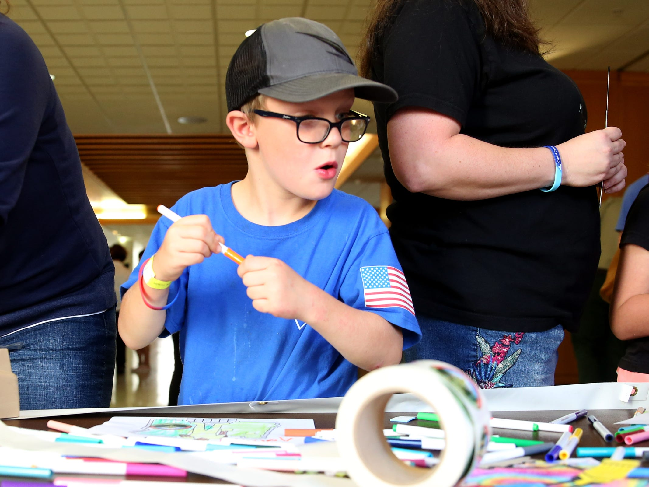 Adam Sheldon, 7, of Salem, colors during an 80th birthday party for the Oregon Pioneer, aka the Gold Man, at the Oregon State Capitol in Salem on Tuesday, Sep. 18, 2018.