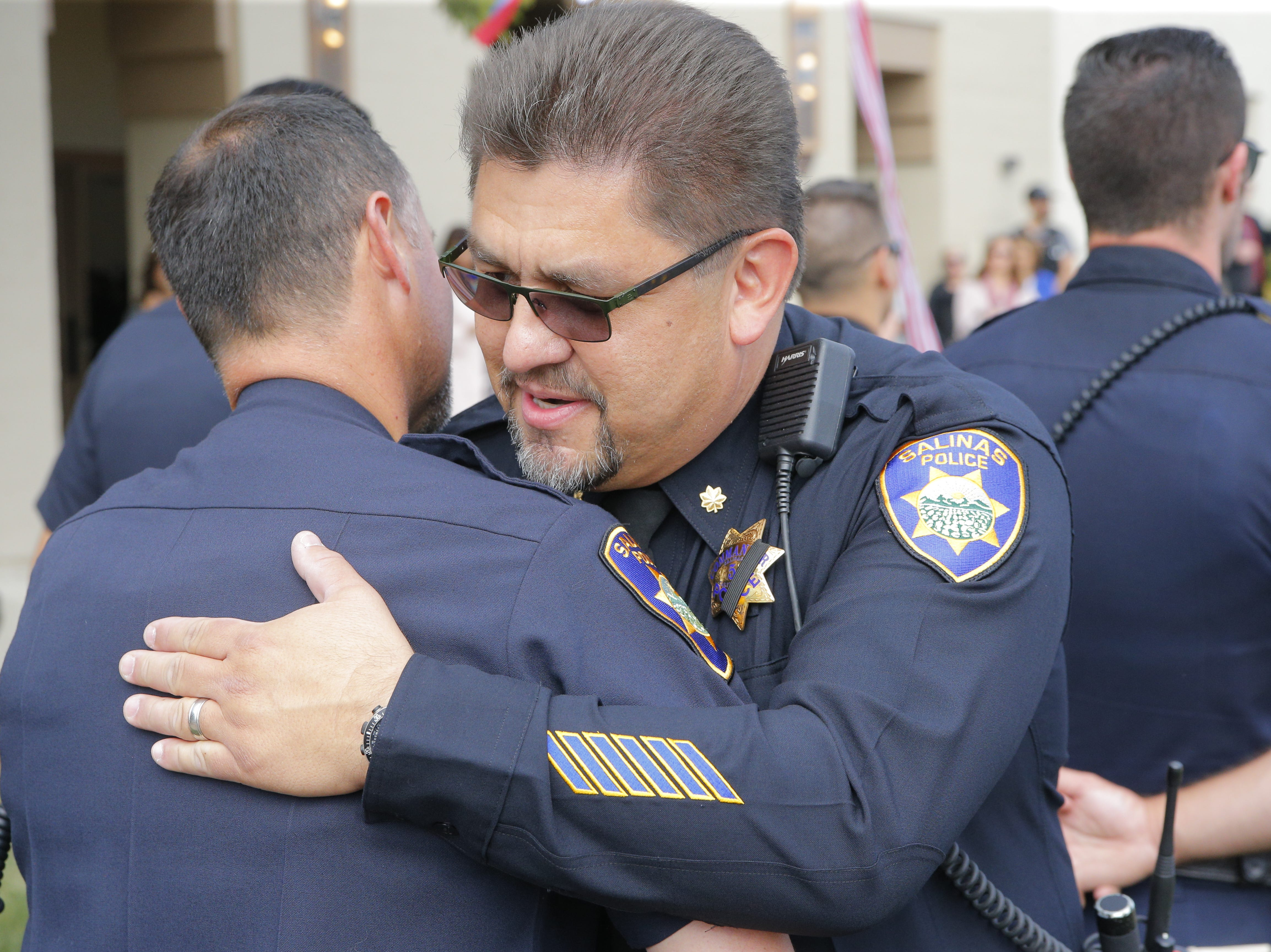 Salinas police honor Cmdr. Henry Gomez's retirement at a ceremony Tuesday.