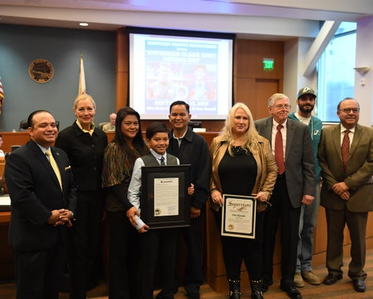 The Monterey County Board of Supervisors meeting Tuesday morning honored Salinas resident Clark Kent Apuada for his achievements in and out of the pool. From left: Supervisors Luis Alejo and Mary Adams, Apuada's mother, Apuada, Apuada's father, coach Dia Rianda, Supervisor John M. Phillips, coach Travis Rianda and Supervisor Simon Salinas.