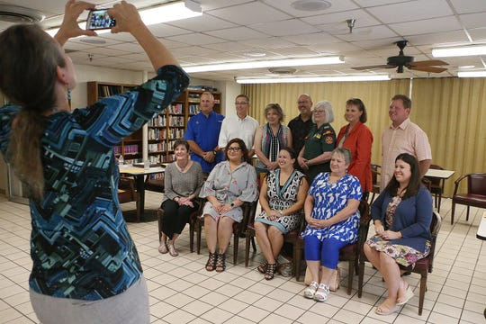Represenatives with local organizations that serve children pose for a group photo after being awarded funding from the San Angelo Downtown Kiwanis Club Tuesday, Sept. 18, 2018.