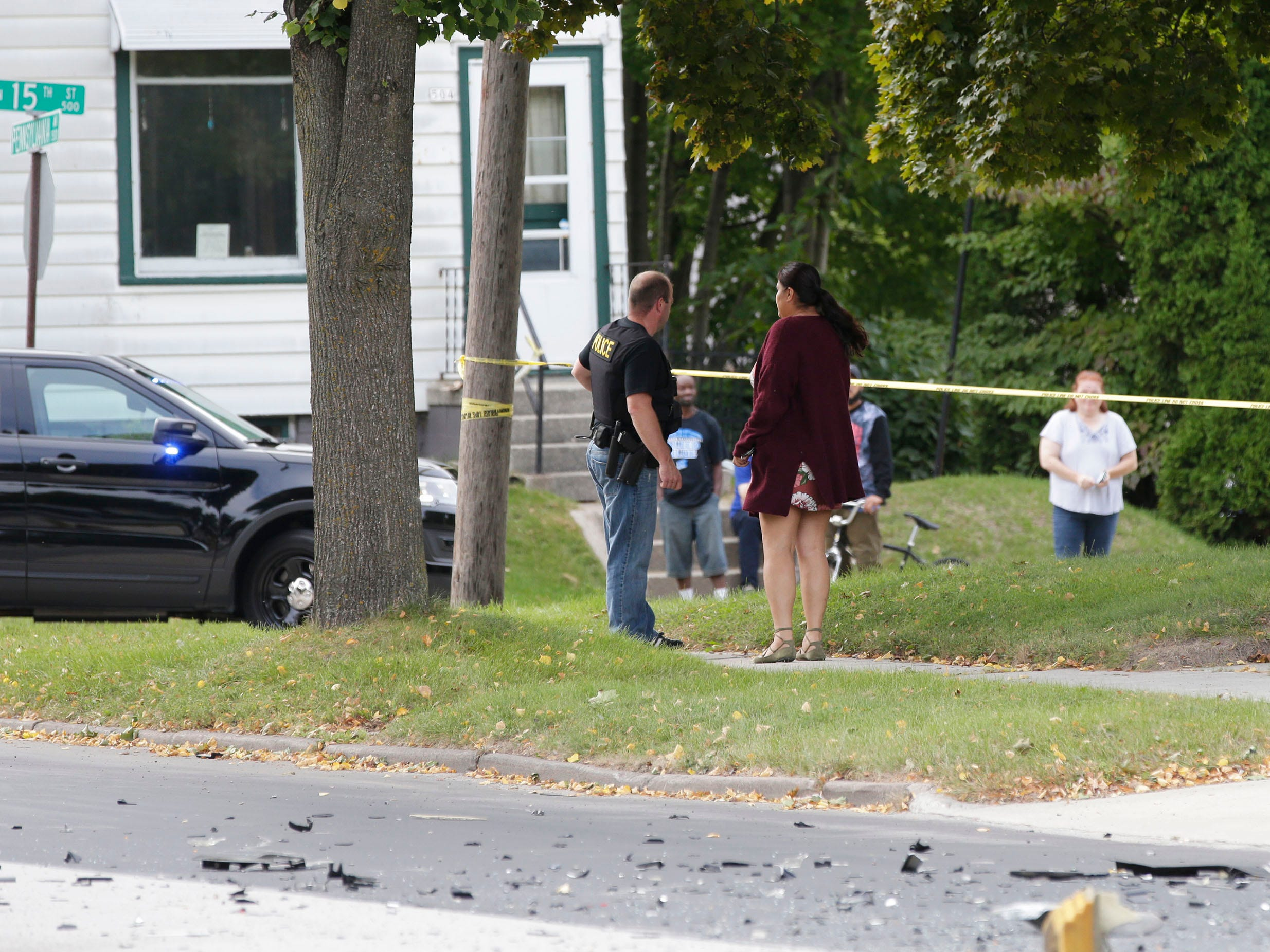 Sheboygan police investigate the scene of a 2-car crash on Pennsylvania Avenue between 14th and 15th streets, Tuesday, September 18, 2018, in Sheboygan, Wis. A third parked car was also struck. Two people died as a result of the crash.