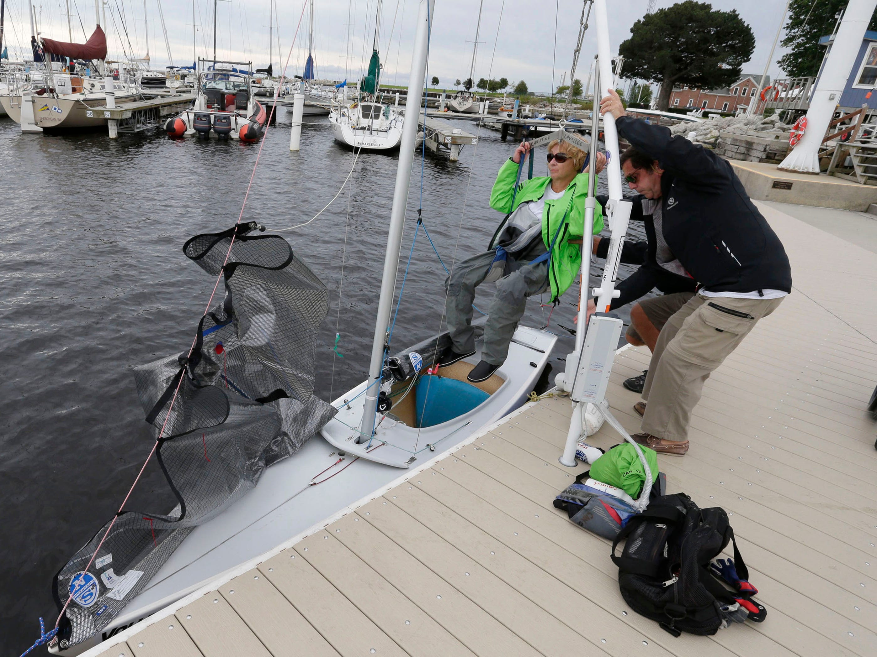 Christine Laballee of Gatineau, Quebec, Canada, is lowered into a sail boat before participating in the Para World Sailing Championships, Tuesday, September 18, 2018, in Sheboygan, Wis.