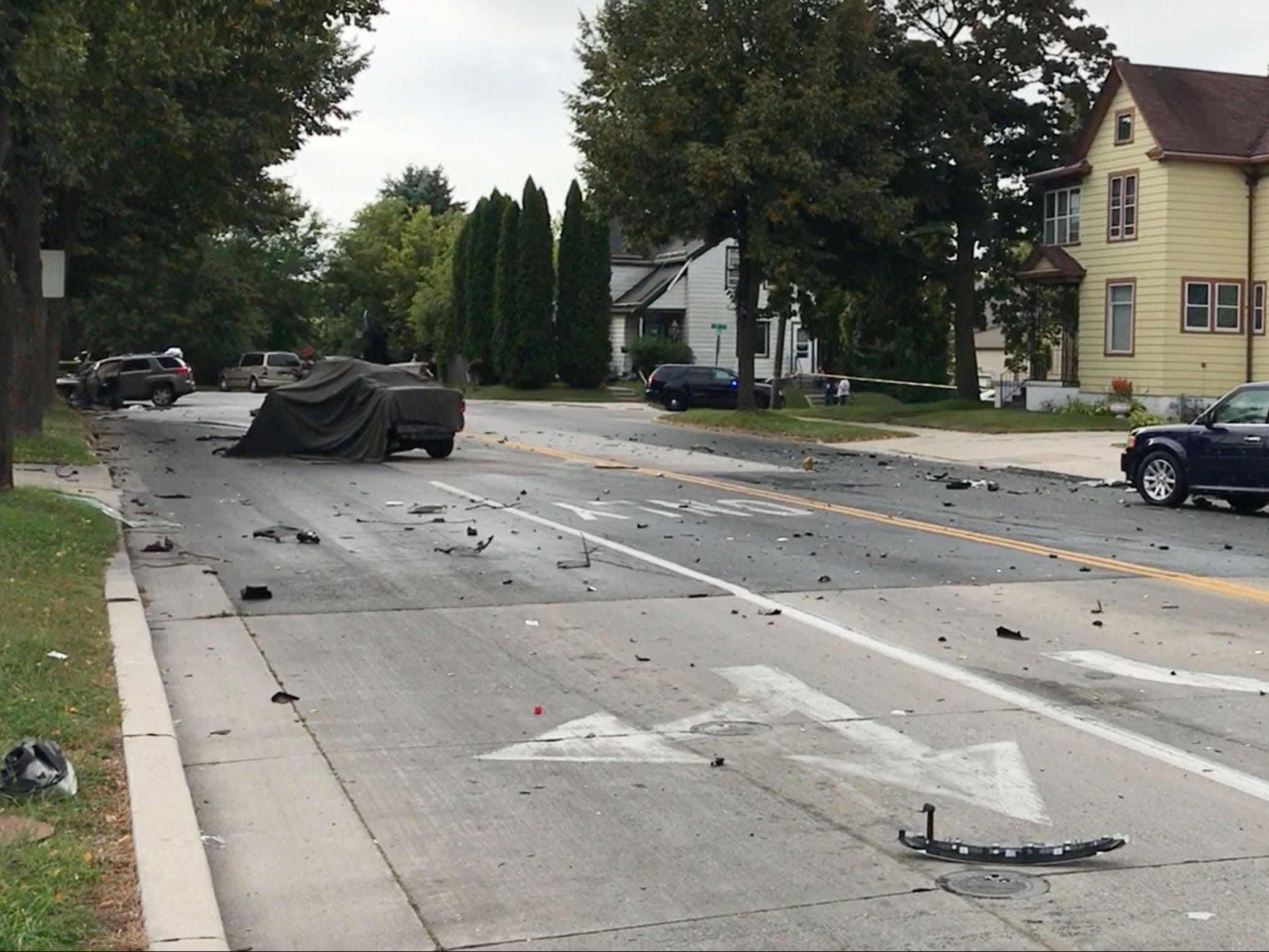 An overall of the scene of a 2-car crash on Pennsylvania Avenue between 14th and 15th streets, Tuesday, September 18, 2018, in Sheboygan, Wis. A third parked car was also struck. Two people died as a result of the crash.