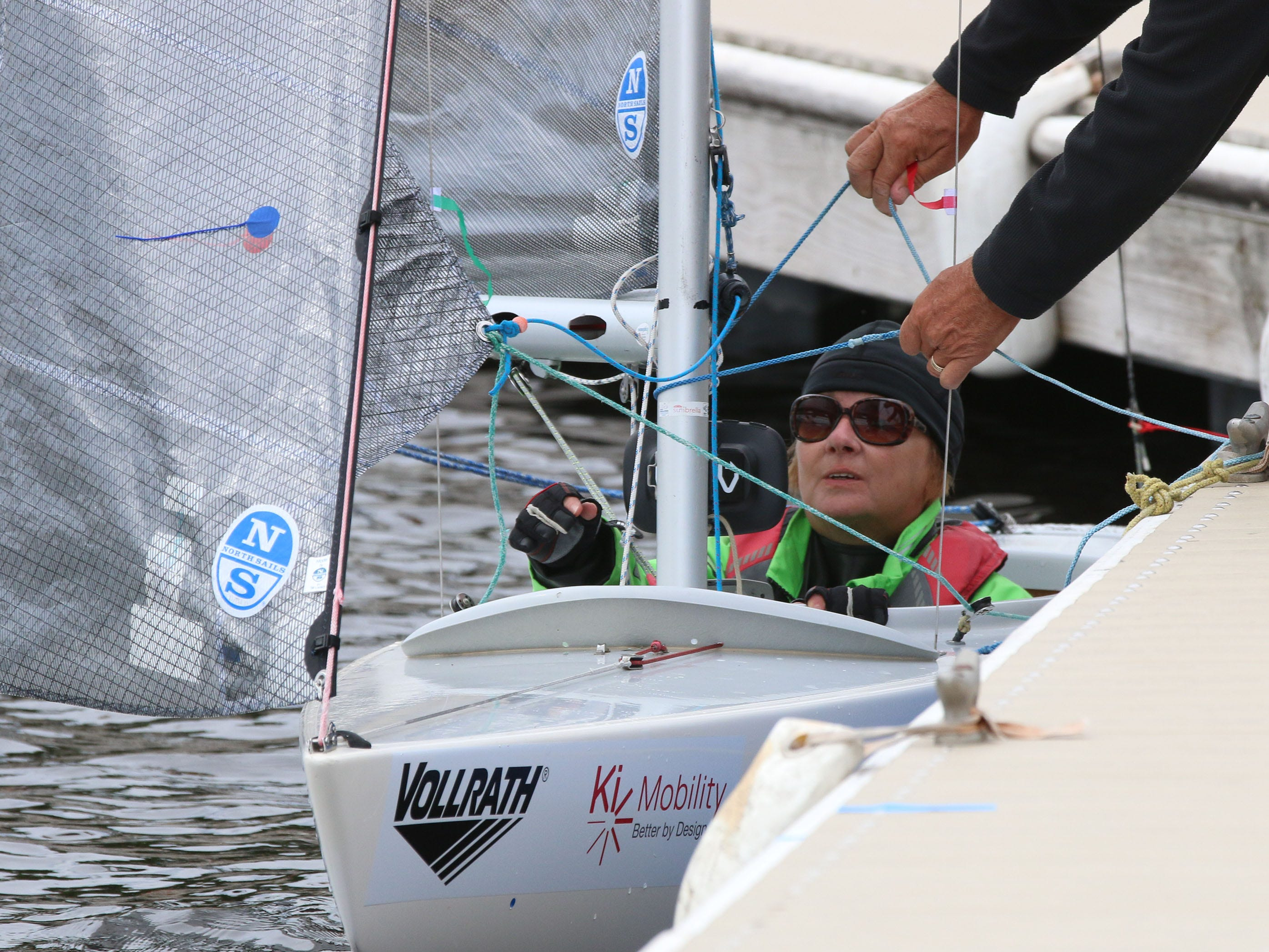 Christine Laballee of Gatineau, Quebec, Canada, observes as her support crew organizes her boat's rigging before her competition in the Para World Sailing Championships, Tuesday, September 18, 2018, in Sheboygan, Wis.