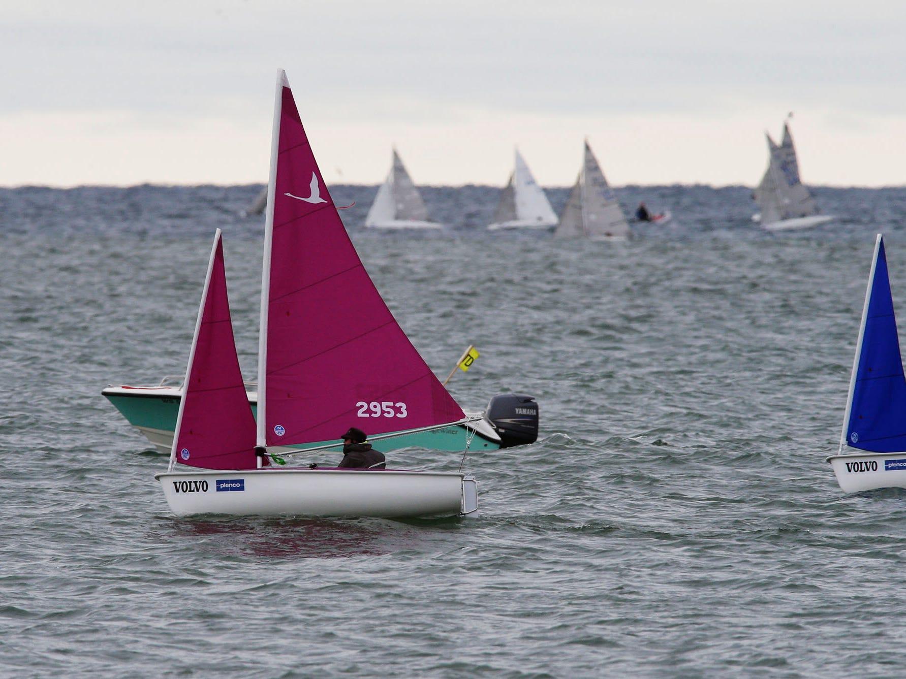 A group of sailors pilot their Hansa 303 sailboats during the Para World Sailing Championships, Tuesday, September 18, 2018, in Sheboygan, Wis.