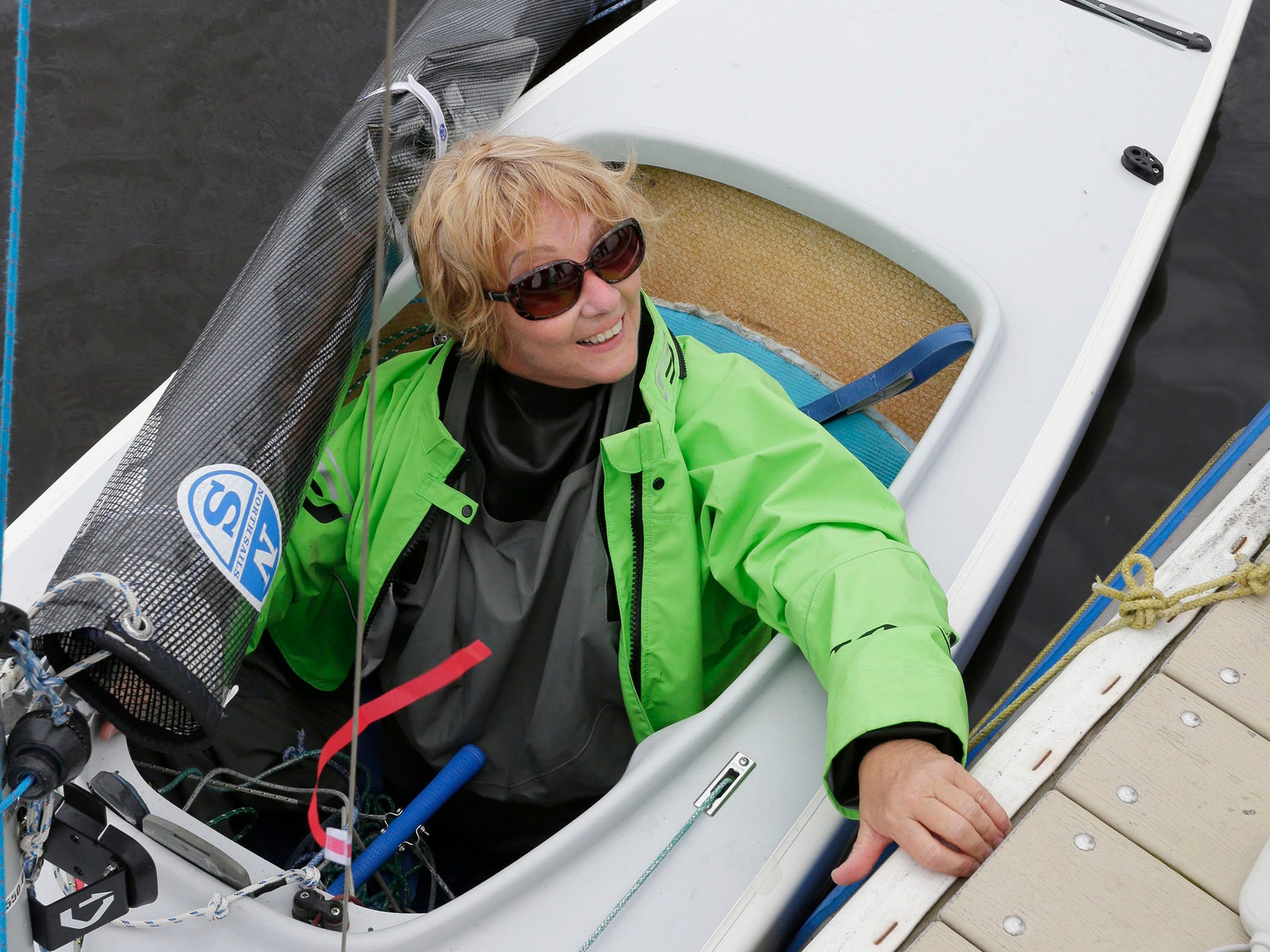 Christine Laballee of Gatineau, Quebec, Canada, is all smiles after being lowered into a sail boat before participating in the Para World Sailing Championships, Tuesday, September 18, 2018, in Sheboygan, Wis.