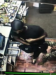 Suspects in a convenience store robbery are seen on surveillnace camera at the Raceway gas station in the 3700 block of Hearne Avenue.