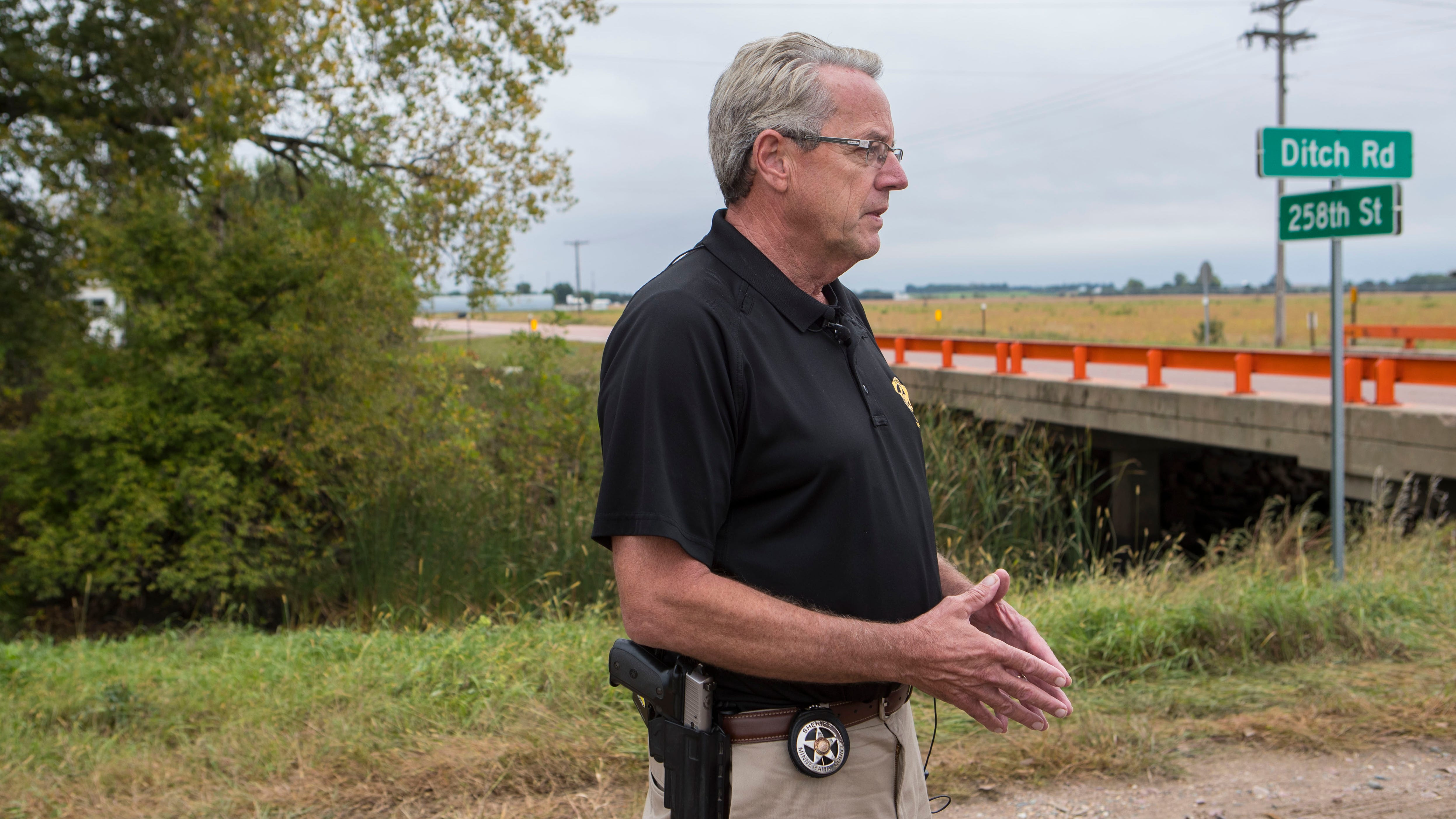 Sheriff Mike Milstead speaks about a body found on Ditch Road on Tuesday, Sept. 18, 2018 in Renner, S.D.