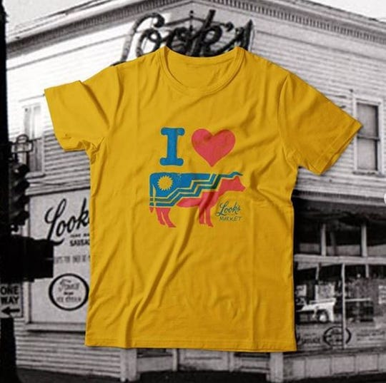 A Looks Market shirt that incorporates the Sioux Falls flag in its design.