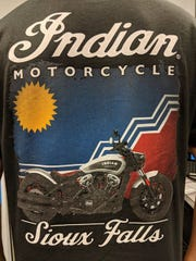 An Indian Motorcycle shirt that incorporates the Sioux Falls flag in its design.