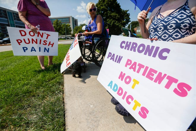 """In this 2018 file photo, chronic pain patients rallied outside of Cox South Hospital. They believe they are being punished by recent CDC guidelines that discourage doctors from writing prescriptions for pain medication. Another """"Don't Punish Pain"""" rally is planned for Wednesday."""
