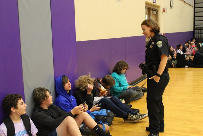 Springfield school police officer Kerri Dutcher interacts with students in the gym at Hickory Hills Elementary and Middle School.