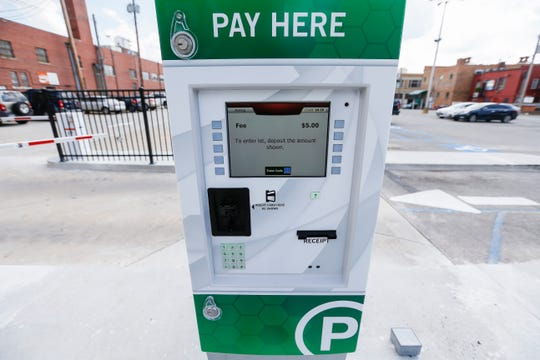 A pay station has been set up at the parking lot between McDaniel Street and Park Central West near Hurts Donut.