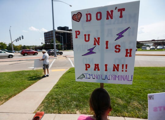 Chronic pain patients held a rally outside of Cox South Hospital on Tuesday, Sep. 18, 2018. They believe they are being punished by recent CDC guidelines that discourage doctors from writing prescriptions for pain medication.