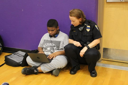 Springfield school police officer Kerri Dutcher interacts with a student in the gym at Hickory Hills Elementary and Middle School. School police officials said positive interaction has led to an uptick in tips.