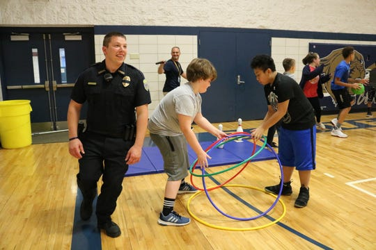 Springfield school police officer Jason Becker interacts with students all day by giving high-fives and fist bumps.