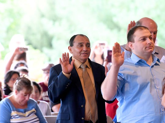 Petitioners seeking citizenship take the Oath of Citizenship and become naturalized American citizens during a naturalization ceremony held at the Frontier Culture Museum on Tuesday, Sept. 18. 2018.