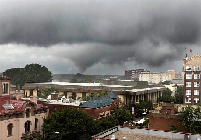 A funnel cloud hangs over the Richmond, Va., skyline, Monday, Sept. 17, 2018. (Bob Brown/Richmond Times-Dispatch via AP)