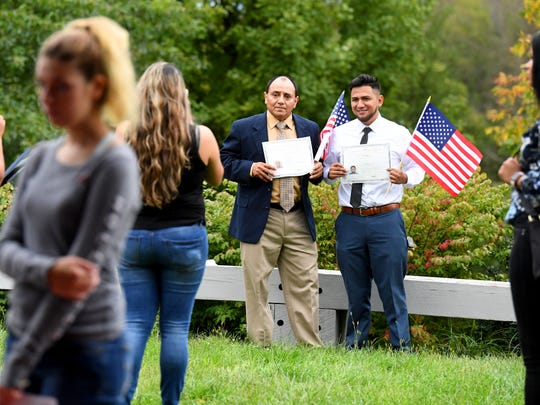 Newly naturalized Americans celebrate with photos after a naturalization ceremony held at the Frontier Culture Museum on Tuesday, Sept. 18. 2018.
