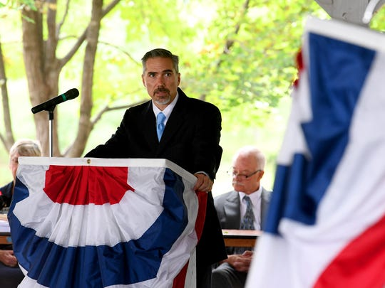 Jeb Terrien, Assistant U.S. Attorney with the U.S. Attorney's Office, presents the petitioners to the court before they take the Oath of Citizenship during a naturalization ceremony held at the Frontier Culture Museum on Tuesday, Sept. 18. 2018.