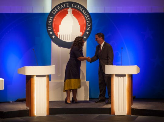 Shireen Ghorbani and Chris Stewart shake hands after the debate Sept. 17, 2018.