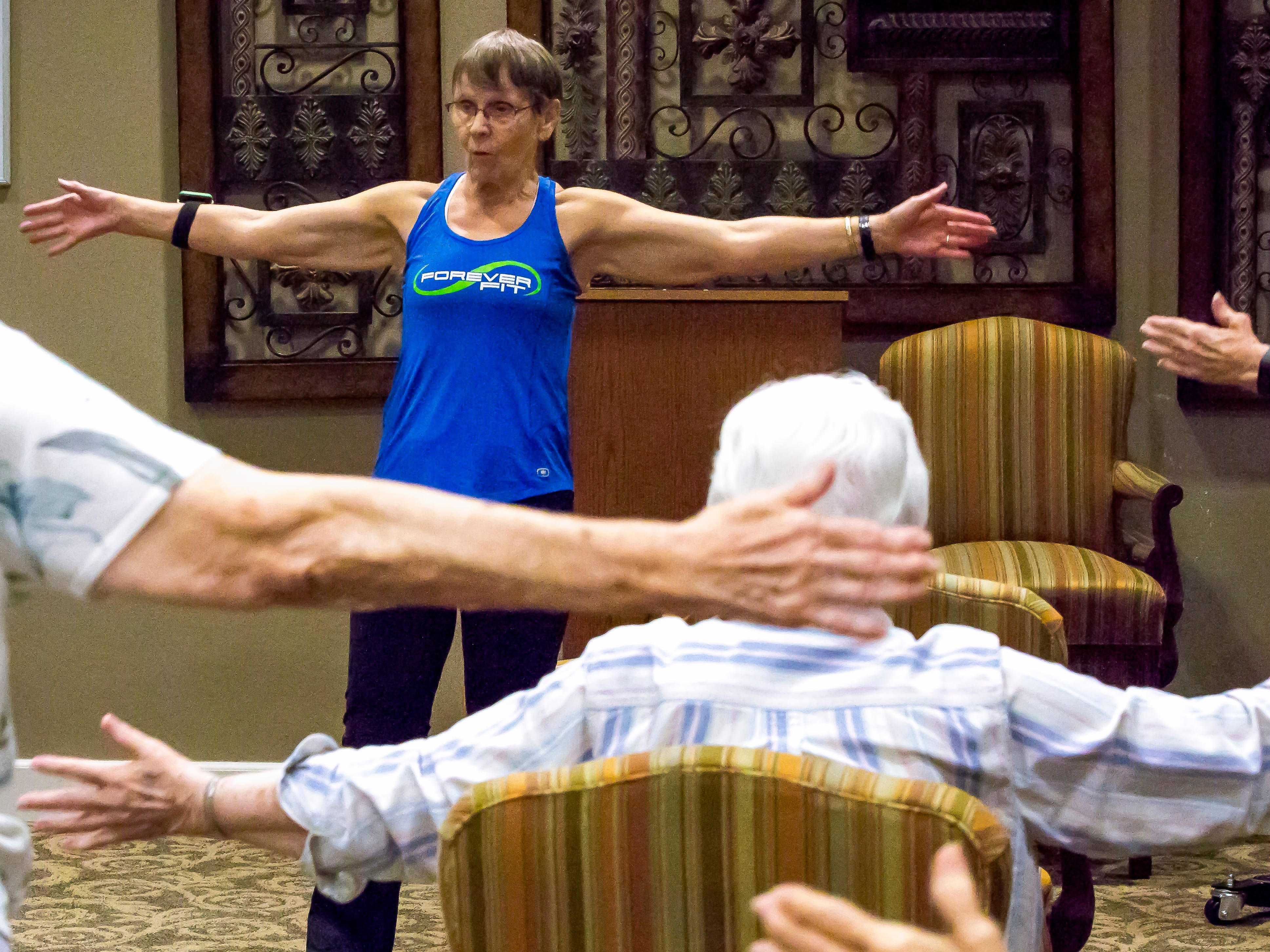 Betty Lou Sweeney leads a fitness class for elderly residents of the Brookdale assisted living facility in Stevens Point, Wis., Tuesday, Sept. 18, 2018. Sweeney volunteers to run the class on a weekly basis.