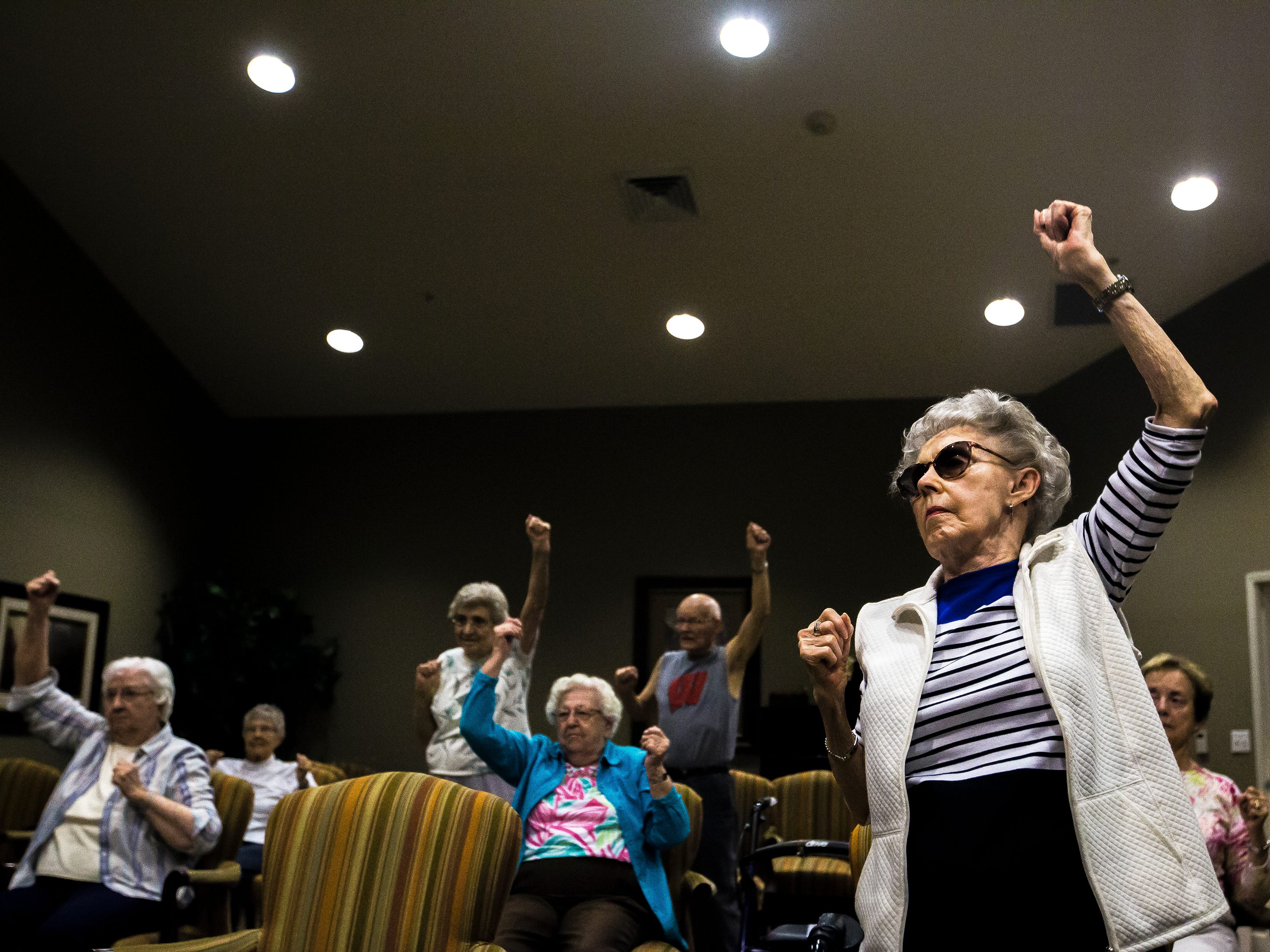 """Doris Roberts, 92, right, participates in a fitness class led by volunteer Betty Lou Sweeney for residents of the Brookdale assisted living facility in Stevens Point, Wis., Tuesday, Sept. 18, 2018. """"You make us better. I wish I had you 30 years ago,"""" Roberts said to Sweeney before the class."""
