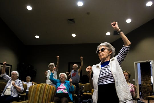 "Doris Roberts, 92, right, participates in a fitness class led by volunteer Betty Lou Sweeney for residents of the Brookdale assisted living facility in Stevens Point, Wis., Tuesday, Sept. 18, 2018. ""You make us better. I wish I had you 30 years ago,"" Roberts said to Sweeney before the class."