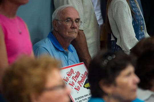An opponent of Virgin Trains USA/Brightline is shown at a workshop on the possibility of a train station in Stuart, Sept. 17, 2018.