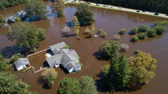 Homes on the Wood family's property are seen severely flooded Tuesday, Sept. 18, 2018, in the aftermath of Florence in Linden, N.C. Dale Wood, who has lived on the property about 47 years, and his wife, Angie Wood, said their home was also flooded by the nearby Little River after Matthew, but not nearly to the same levels.