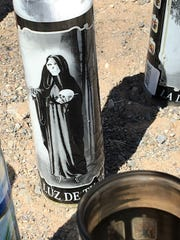 Santa Muerte candles were part of a memorial for three El Paso teens killed in a shooting on Lincoln Avenue.