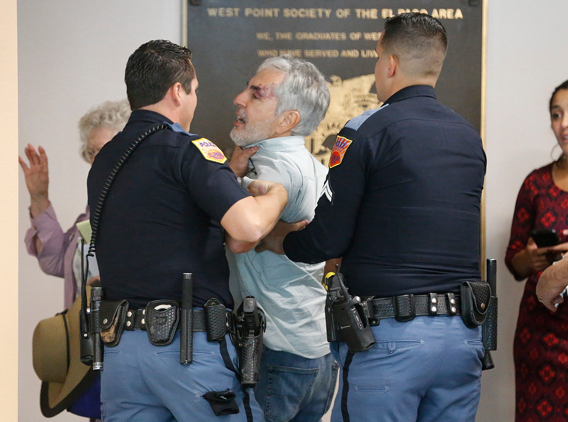 """El Paso police officers took Jud Burgess into custody moments after the City Council voted 7-1 to place the Mexican American Cultural Center at the Downtown library. As public comment on the plan was about to begin, Burgess went up to City Manager Tommy Gonzalez and yelled """"this was all a sideshow you all wasted our time."""""""