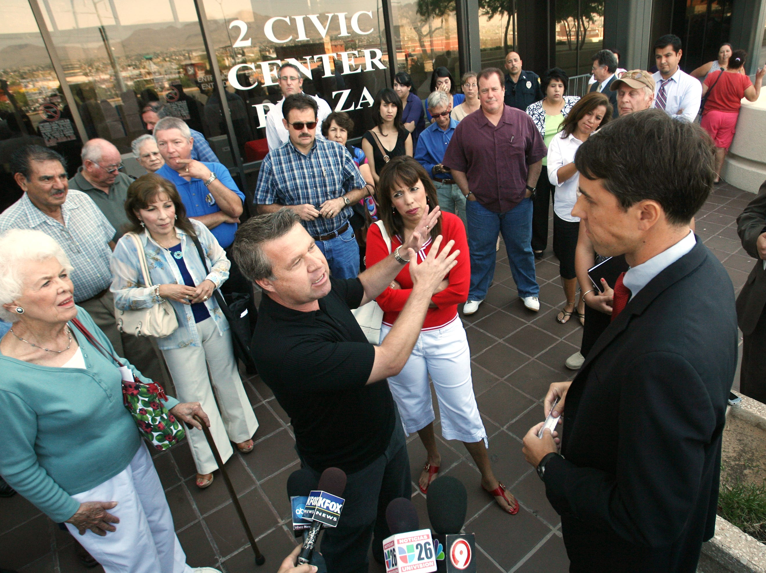 """Tom Brown, foreground left, makes a point to city Rep. Beto O""""Rourke during a short meeting Tuesday morning outside City Hall. O""""Rourke met with a group of people to talk about the city ís proposal to provide benefits to unmarried couples, including gay and lesbian couples."""